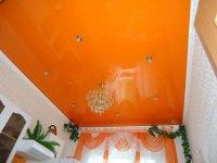 Оранжевый натяжной потолок для кухни